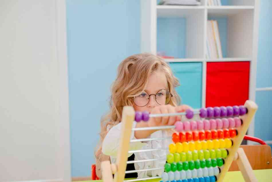 Girl with ASD playing with abacus