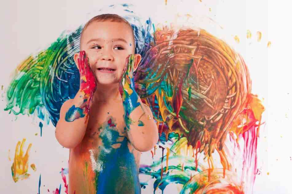 Boy covered in finger paint