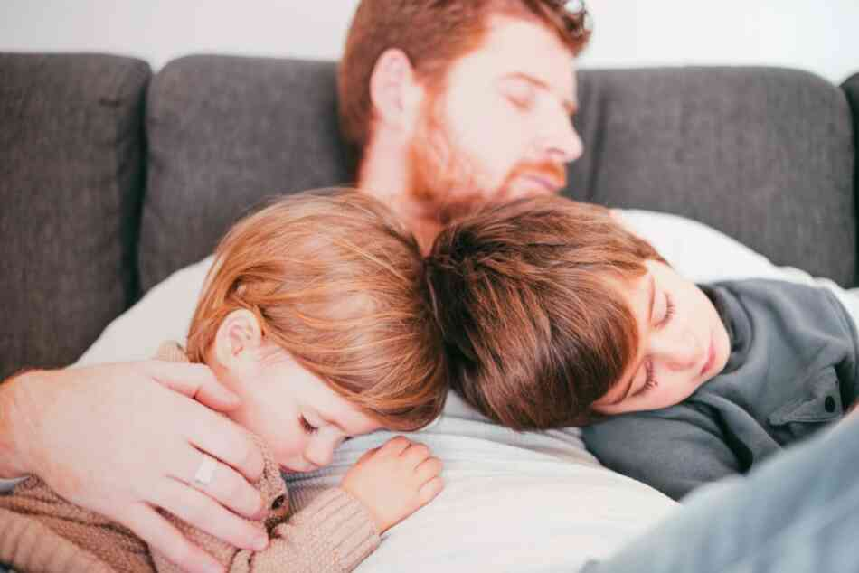 Dad and kids asleep on couch