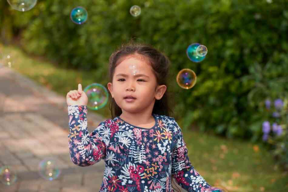 Girl blowing bubbles outdoors