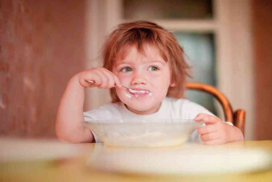 Toddler eating from bowl