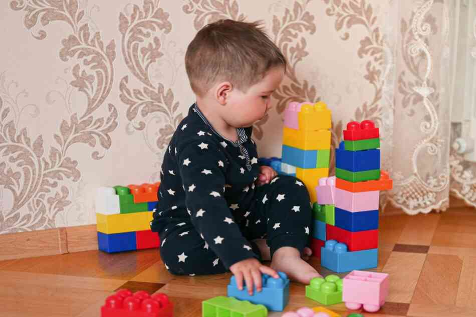 ASD toddler playing with blocks