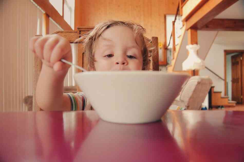 Boy eating from bowl