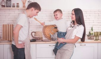 Father, mother, and son making a meal