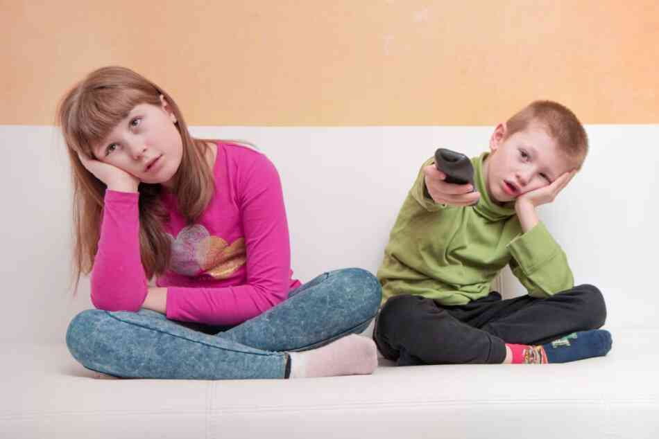Girl and boy bored of TV