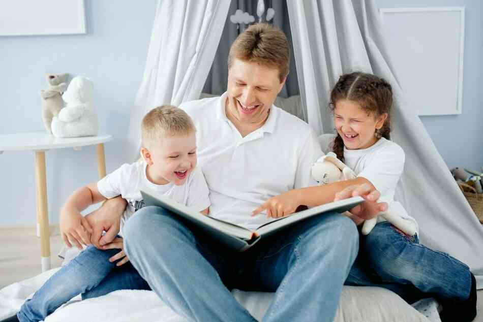 father reading with children