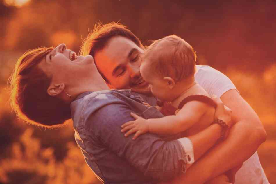 Mom and dad laughing with baby