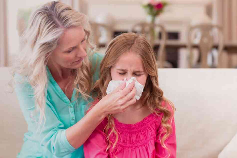 Mother wipes allergic daughter's nose