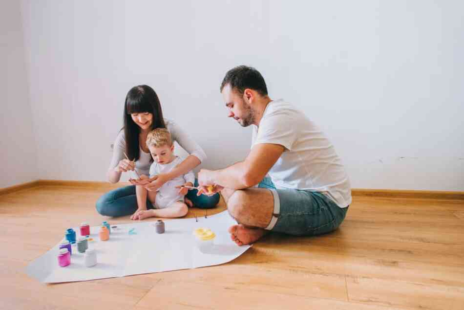 Parents painting with child