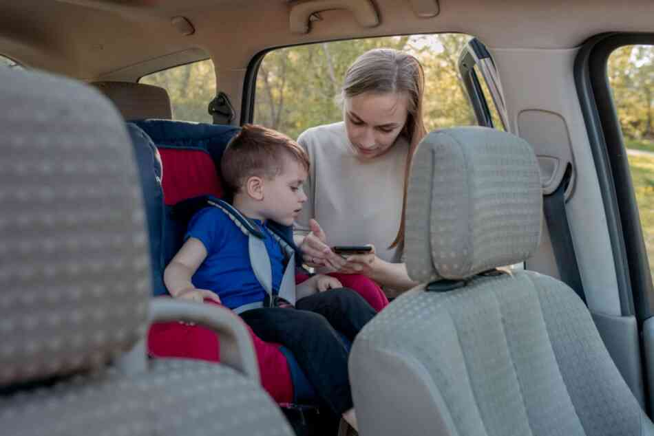 Mom with boy in car seat