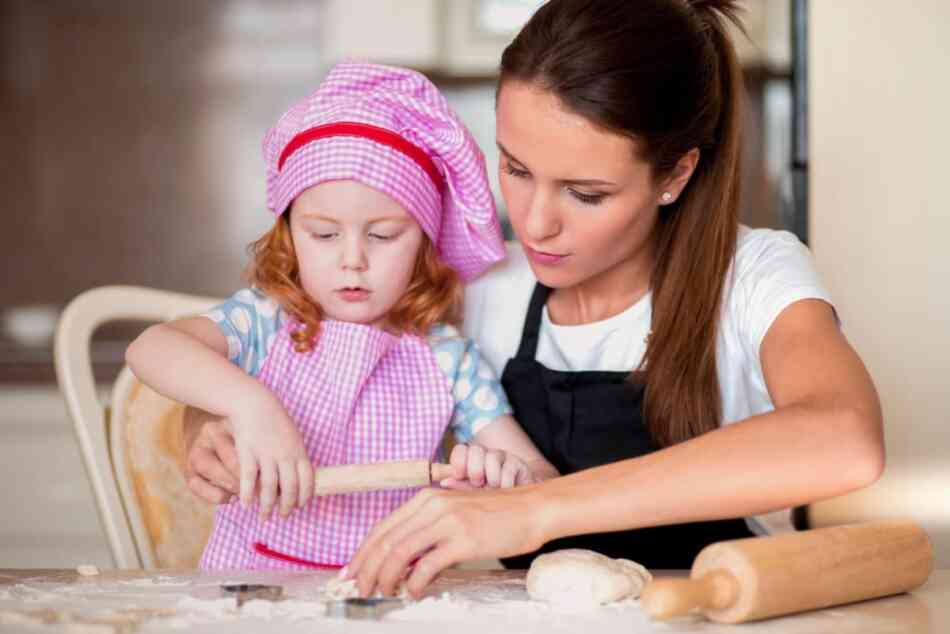 Nanny baking with girl