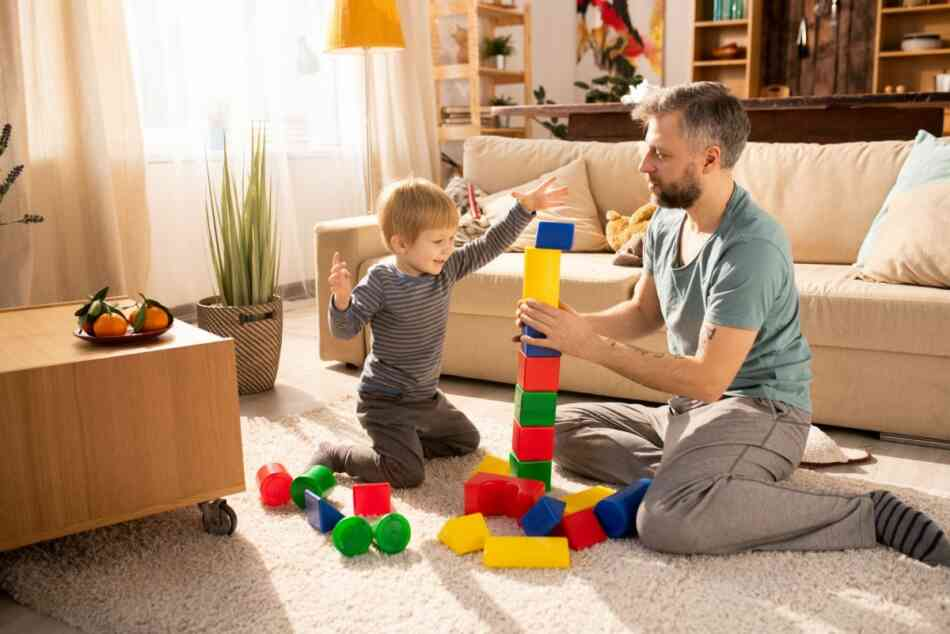 Father and son build tower