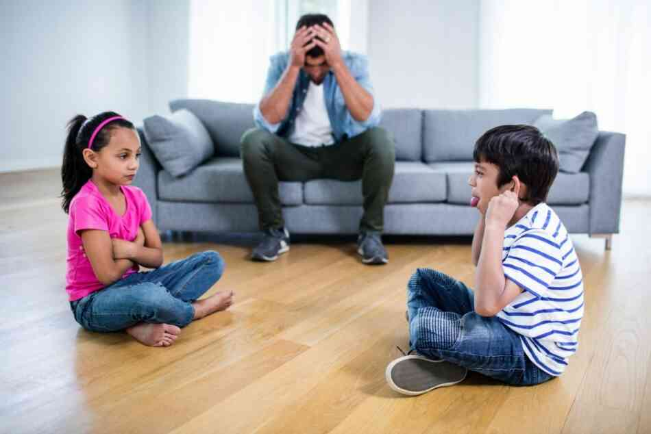 frustrated dad with feuding kids
