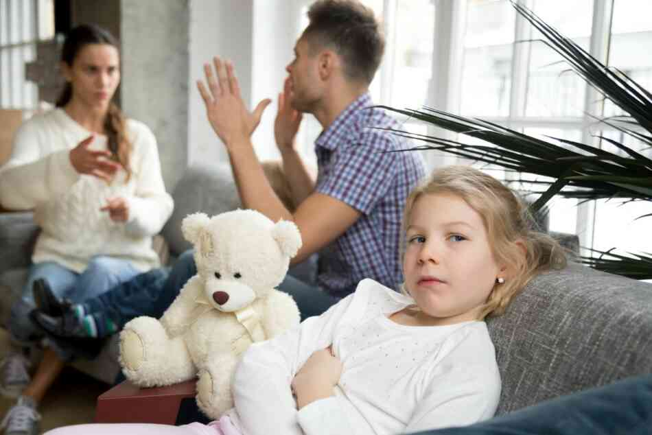 little girl upset at mom and dad arguing