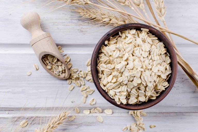 oat-flakes-ceramic-bowl-wooden-spoon-spikelets
