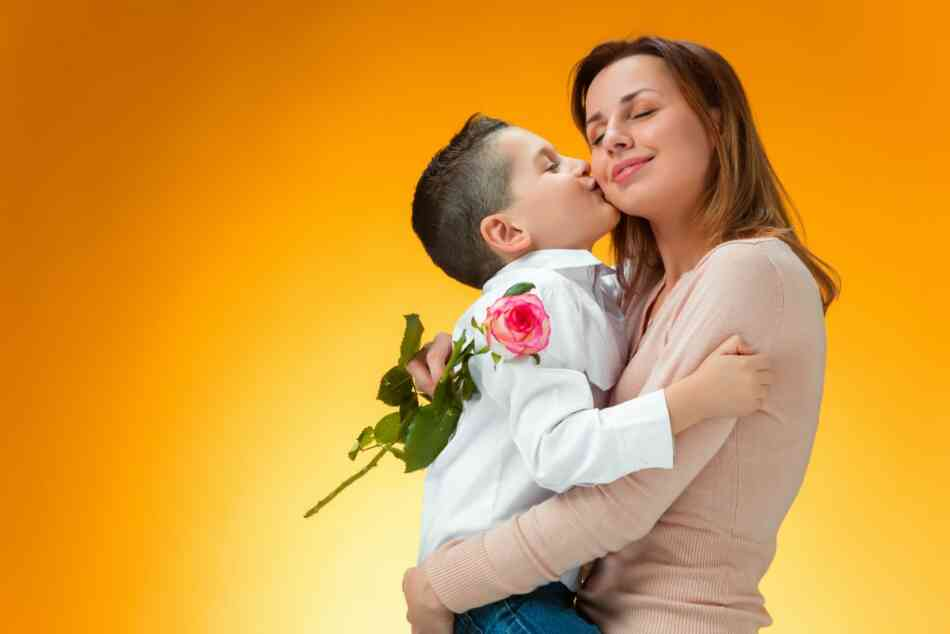 boy gives mom rose and kiss
