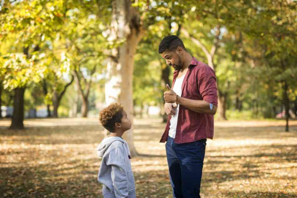 father disciplines anxious child