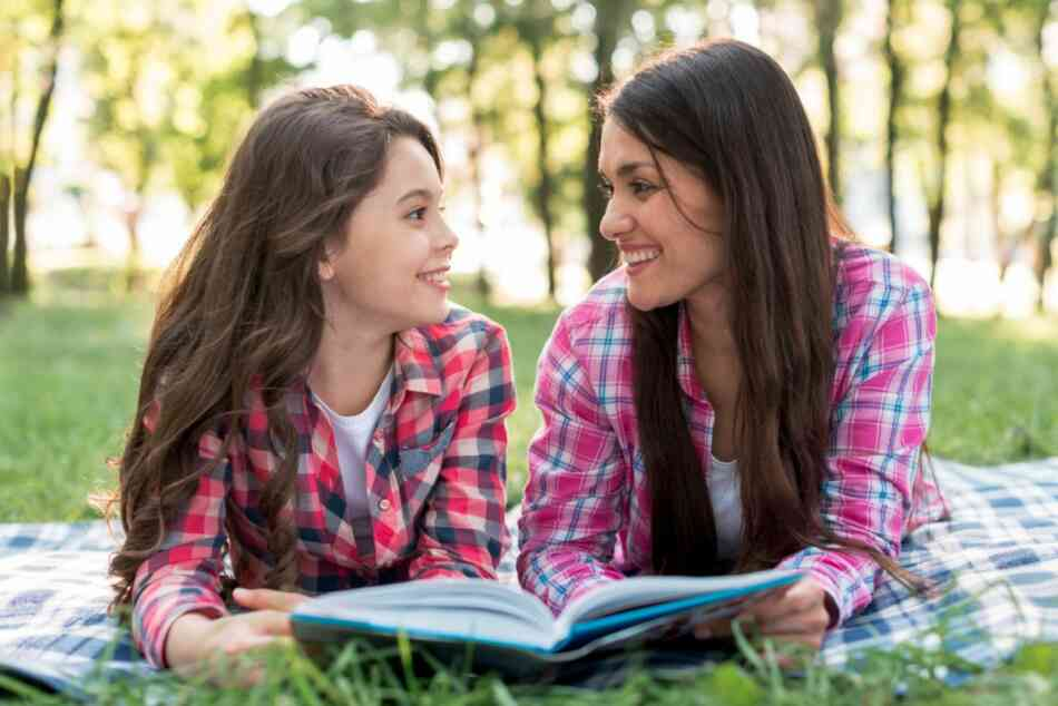 mom and daughter reading puberty book
