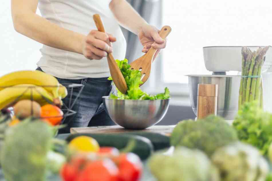 pregnant woman serving healthy food