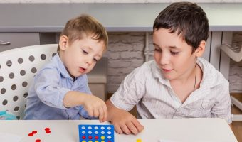 two 6 year olds playing a board game