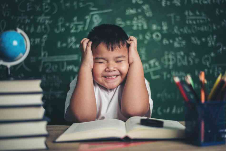 boy bothered by noise in classroom
