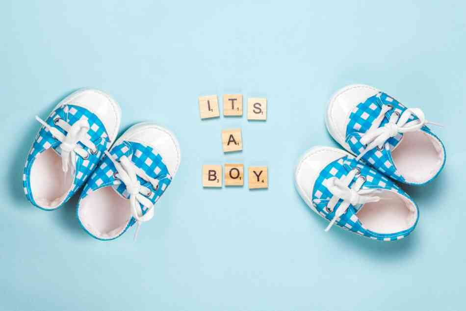 baby shoes revealing it's a boy