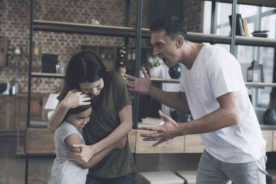 Man shouting at a woman and child