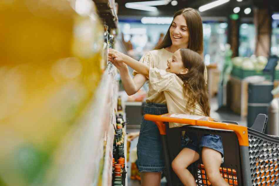 mom happily shopping with toddler