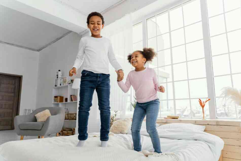 hyper kids jumping on bed