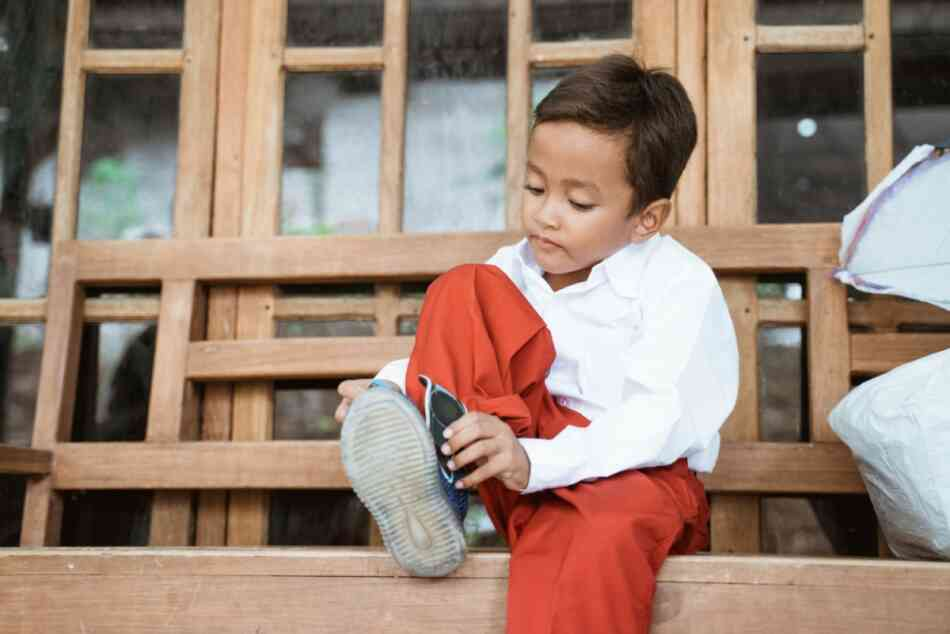 ADHD kid ties shoes as part of morning routine