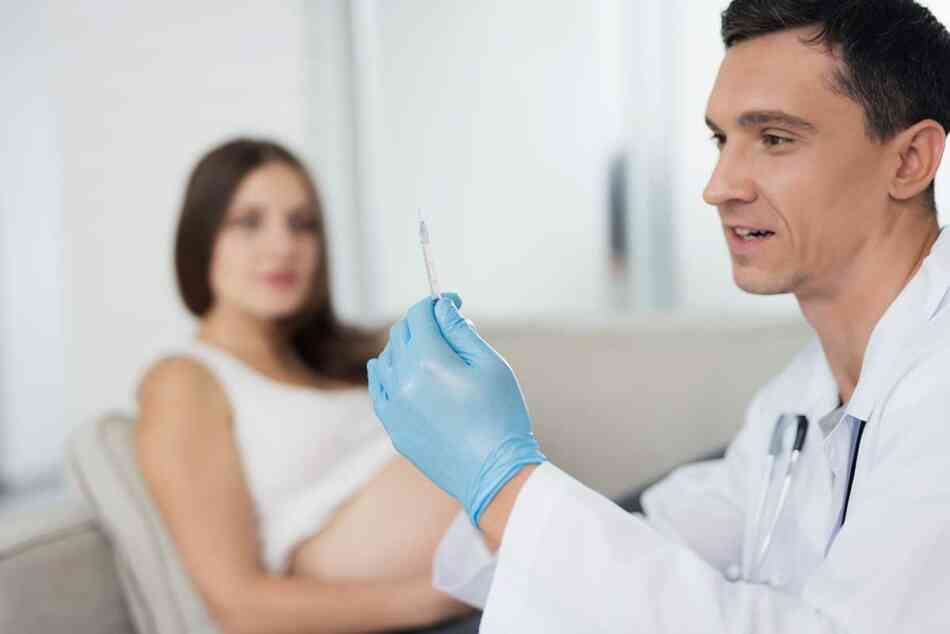pregnant woman about to receive vaccine