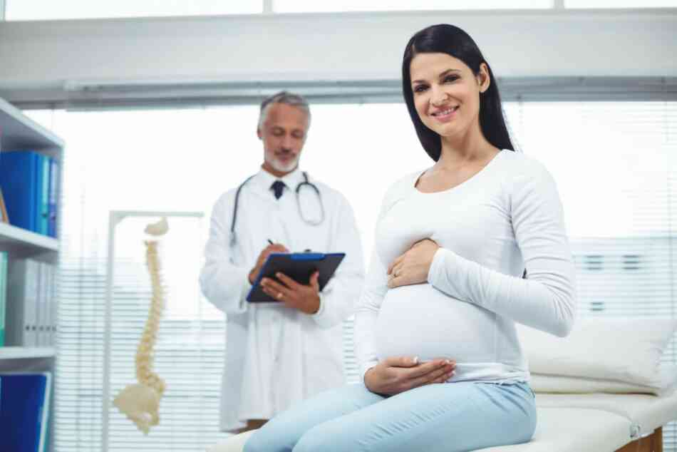 pregnant woman at doctor's clinic