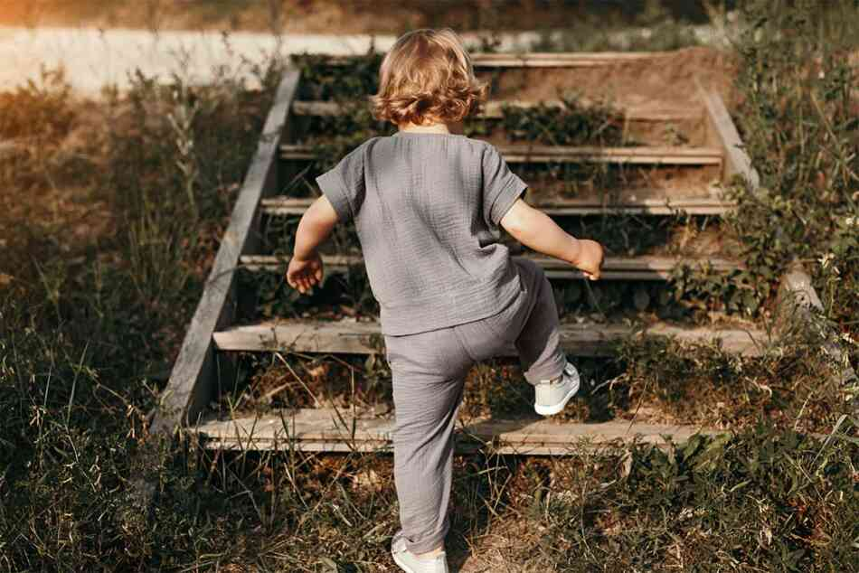 toddler climbing up the stairs