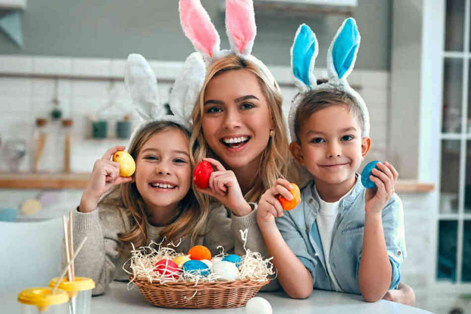 mom and kids with Easter eggs