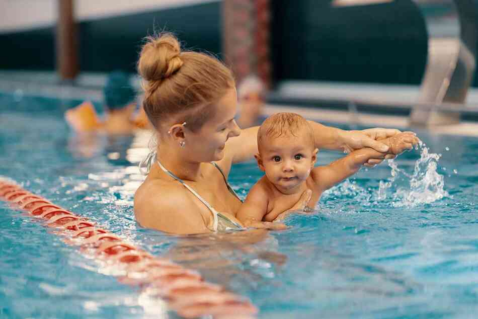 baby and mom at a swimming lesson in the pool