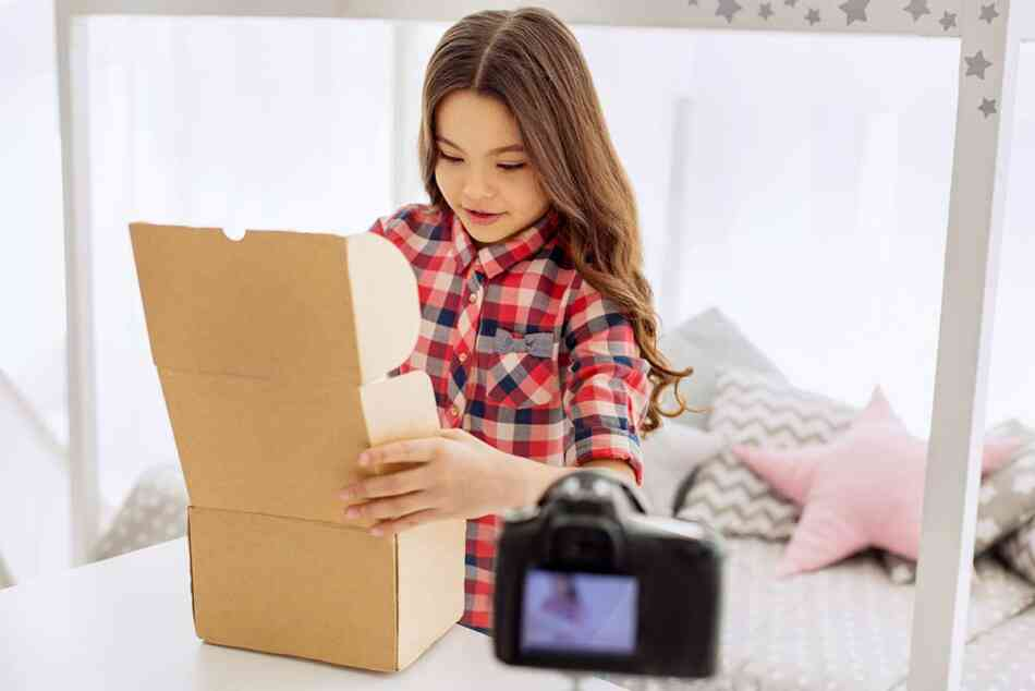 Young Girl Opening Box