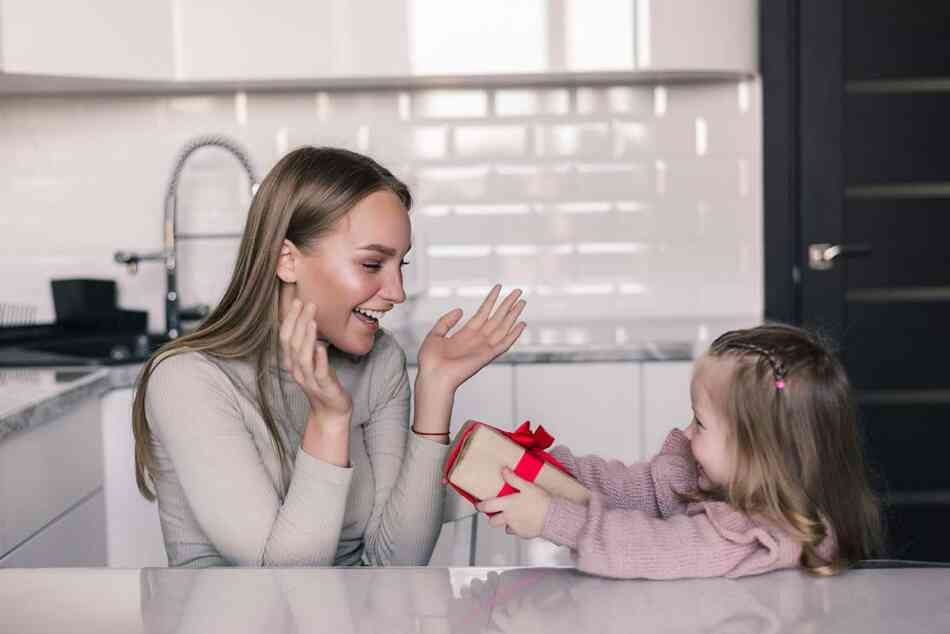 young-daughter-gifting-mom
