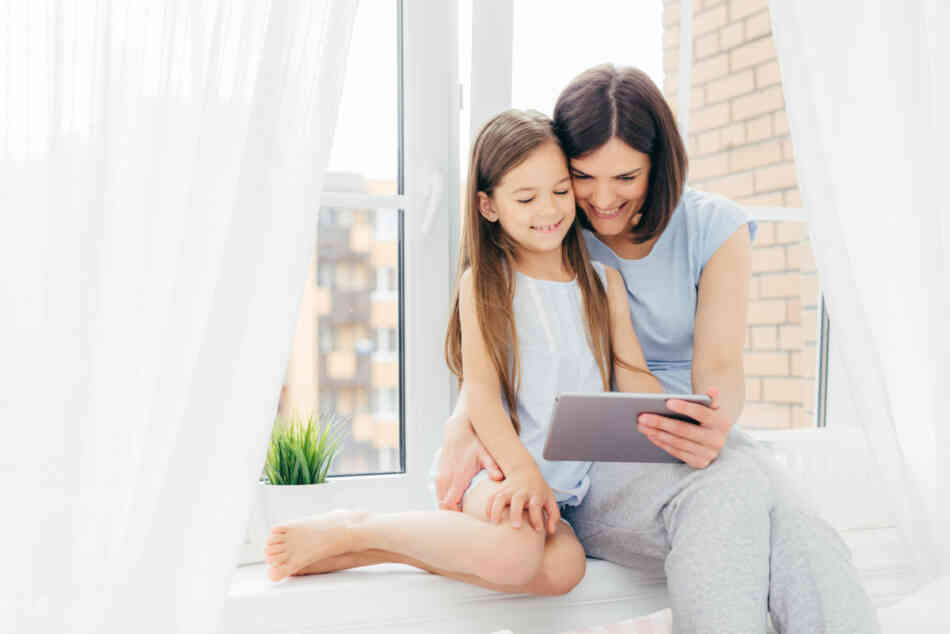mother and daughter watching storytime videos