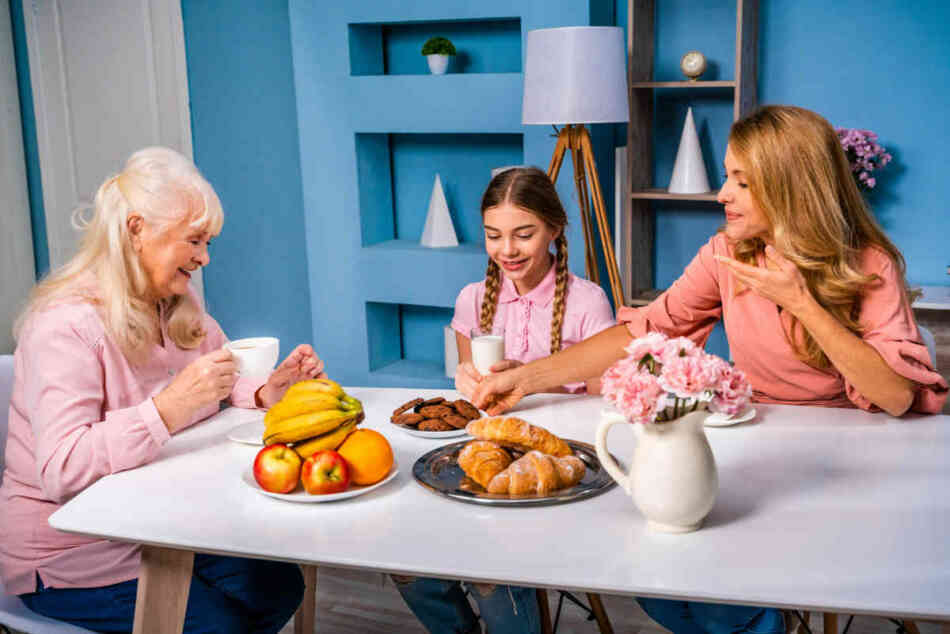 grandma mom and daughter eat together