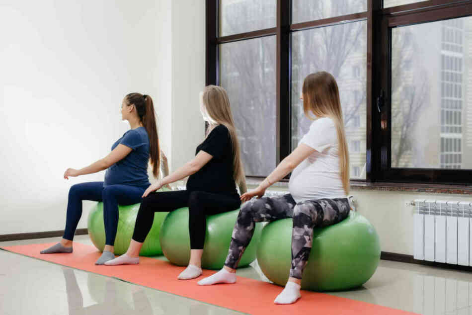 group-young-pregnant-mothers-are-engaged-pilates-ball-sports-fitness-club