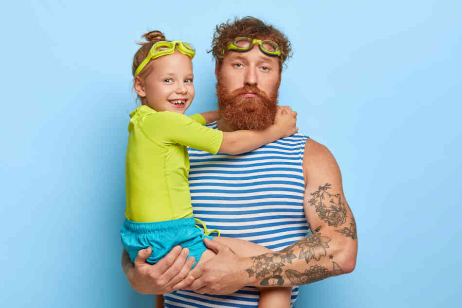 man and daughter in swim goggles