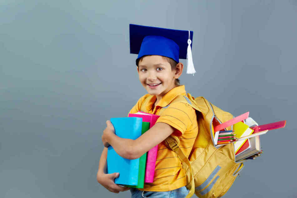 gifted kid overloaded with books and school supplies