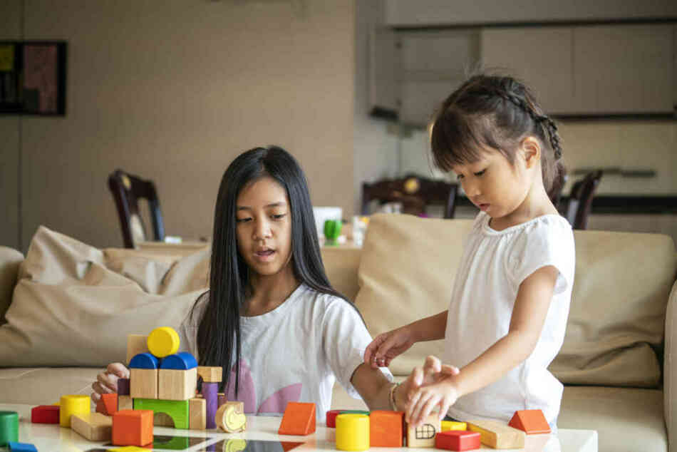 Asian girl spend quality time together for playing wooden block