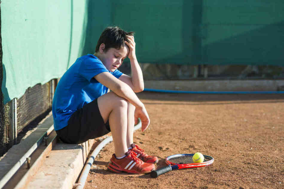 young kid burned out from playing tennis