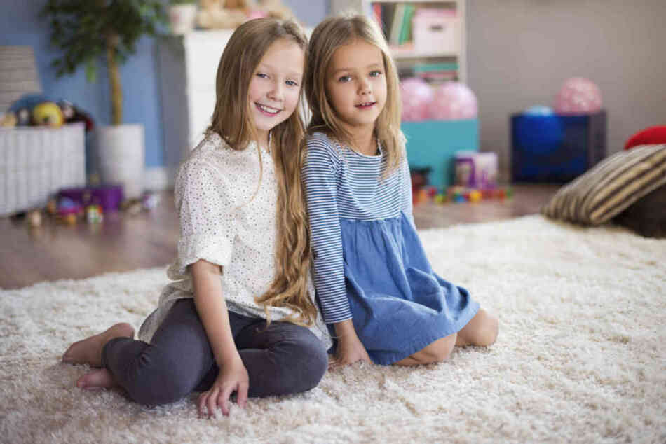 two young girls bonding during play