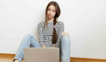 bored teen girl searching for things to watch with parents