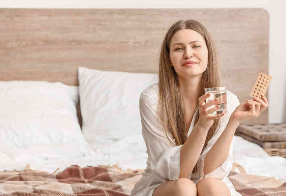woman wondering whether to take birth control pills or stop