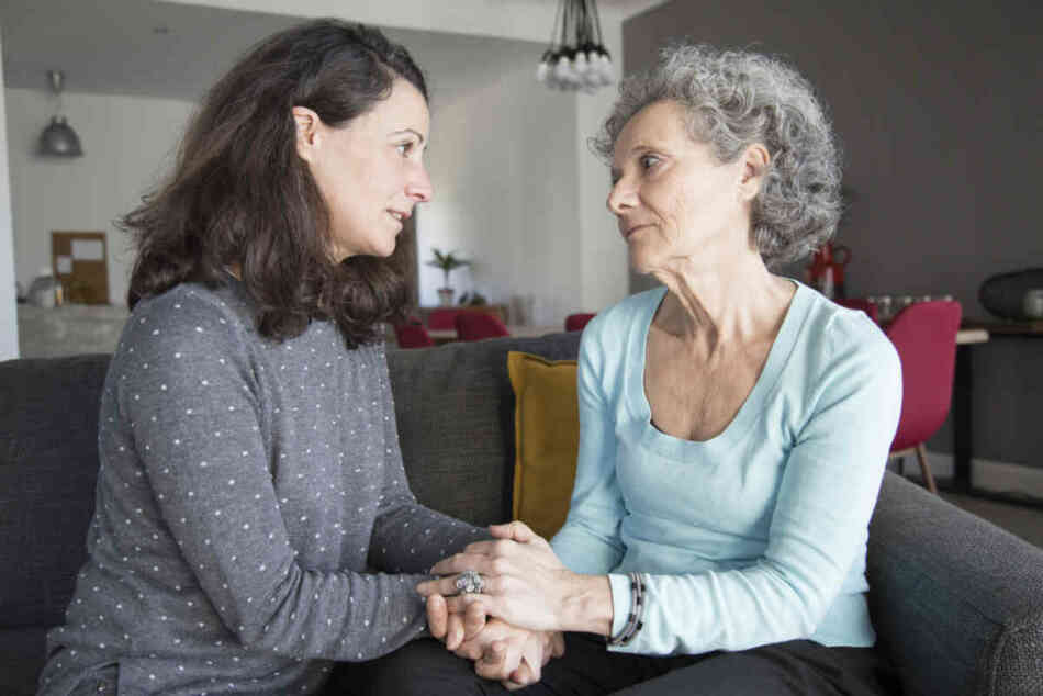 elderly parent having the pregnancy talk with middle aged daughter