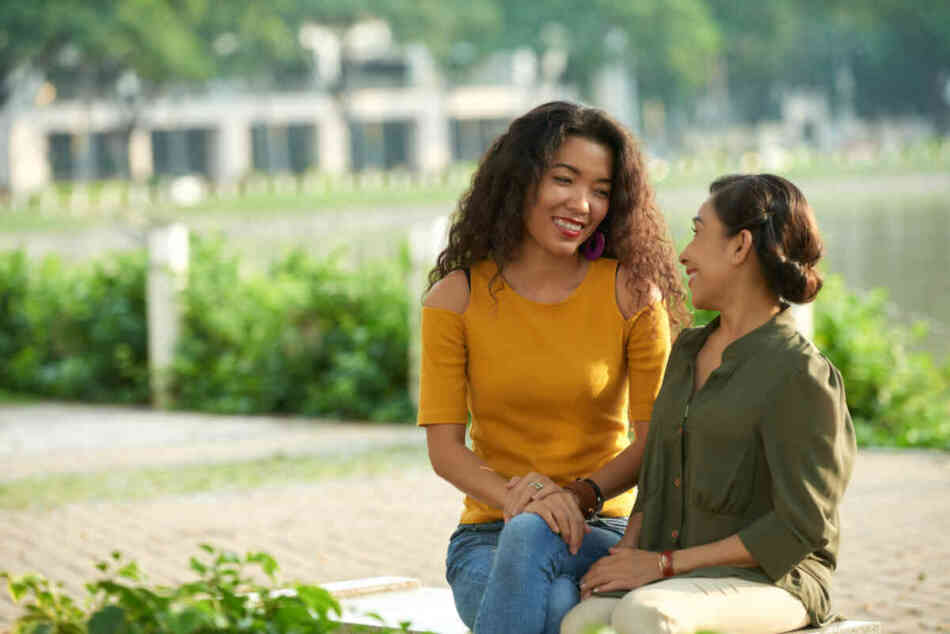 new mom having conversation with friend