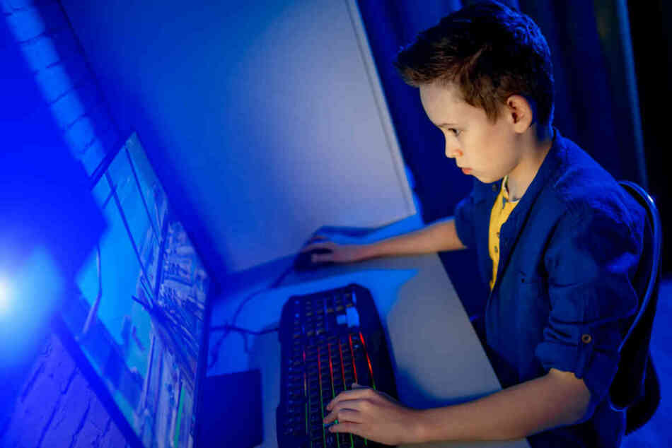 young kid playing video games